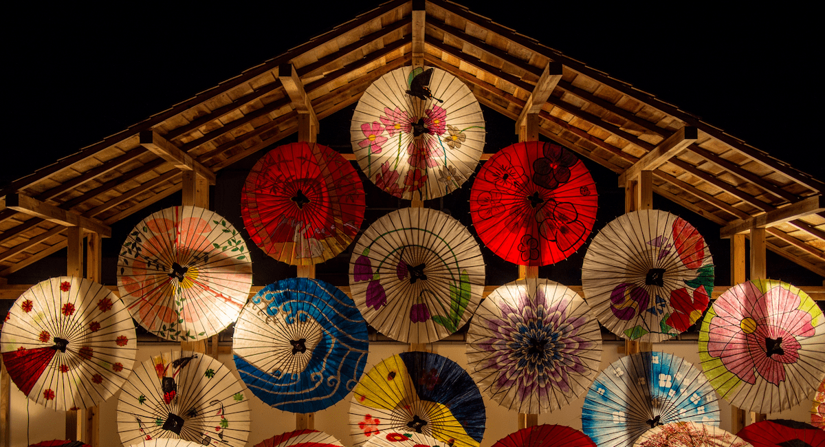 https://www.pexels.com/photo/red-and-white-umbrella-during-night-time-39079/